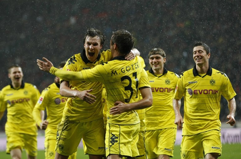 Borussia Dortmund's players celebrate a goal against Bayer Leverkusen during the German Bundesliga soccer match in Leverkusen
