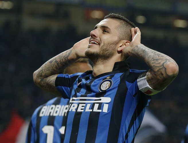 Inter Milan's Mauro Icardi celebrates after scoring during a Serie A soccer match between Inter Milan and Frosinone at the San Siro stadium in Milan, Italy, Sunday, Nov. 22, 2015. (AP Photo/Luca Bruno)