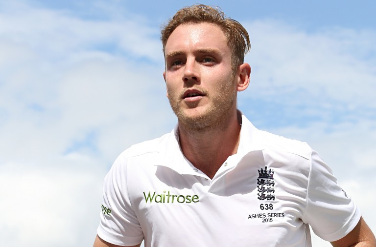 England's Stuart Broad leaves the field with the ball in his hand