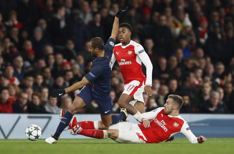 Britain Football Soccer - Arsenal v Paris Saint-Germain - UEFA Champions League Group Stage - Group A - Emirates Stadium, London, England - 23/11/16 Paris Saint-Germain's Lucas Moura in action with Arsenal's Aaron Ramsey and Alex Iwobi  Reuters / Stefan Wermuth Livepic EDITORIAL USE ONLY.