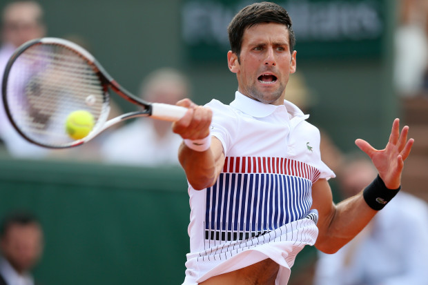 Serbia's Novak Djokovic returns the ball to Portugal's Joao Sousa in their second round match of the French Open tennis tournament at the Roland Garros stadium, Wednesday, May 31, 2017 in Paris. Djokovic won 6-1, 6-4, 6-3. (AP Photo/David Vincent)