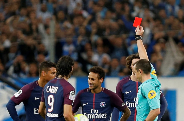 Soccer Football - Ligue 1 - Olympique de Marseille vs Paris St Germain - Orange Velodrome, Marseille, France - October 22, 2017   Paris Saint-Germain's Neymar is shown a red card by referee Ruddy Buquet            REUTERS/Philippe Laurenson