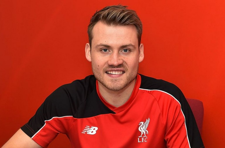 Simon-Mignolet-of-Liverpool-signs-a-new-contract-at-Melwood-Training-Ground-on-January-18-2016